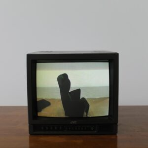 Old television set showing armchair